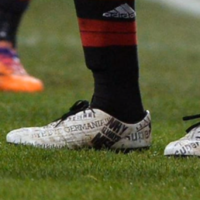 Mario Balotelli has headlines about him printed on his boots