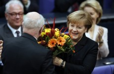 Three months after election, 'grand coalition' elects Angela Merkel as chancellor