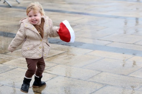 Indy Toaner (3) from Bray joined around 200 brave people who gathered in Dun Laoghaire yesterday - despite the weather - to try and break a world record for the most people in one place wearing Santa hats.