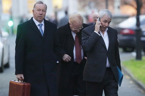 CRC director David Martin (lefft), chairman James Nugent (centre behind) and former CEO Paul Kiely (right) leaving Leinster House earlier this month