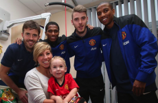 Heartwarming pics as Premier League stars make Christmas hospital visit
