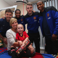 Heartwarming pics as Premier League stars make Christmas hospital visit