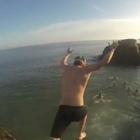 VIDEO: Christmas Day crowds queue up to leap into the icy waters at the 40 Foot