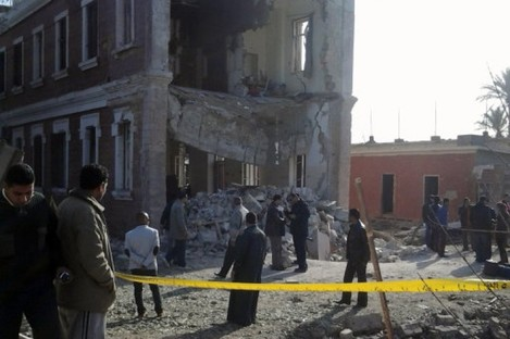 Security personnel at the site of an explosion outside a military intelligence building in Anshas.
