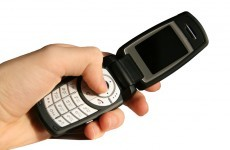 Disappointed mugger hands retro flip phone back to victim