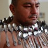 Magnetic man breaks own record by sticking 53 spoons to his body