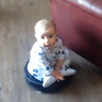 You'll never be as gangster as this baby riding a roomba hoover