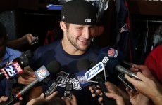 ESPN has hired Tim Tebow