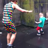 Small boy steals show from dancing street performer