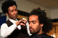 Tom Huddlestone finally gets his mop chopped... live on television