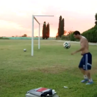 Lionel Messi scores from behind the goal in training