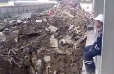 Construction worker lights cigarette in the most incredibly badass way