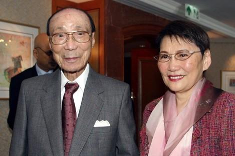 Hong Kong movie producer Run Run Shaw poses with his wife Mona Fong in Hong Kong.