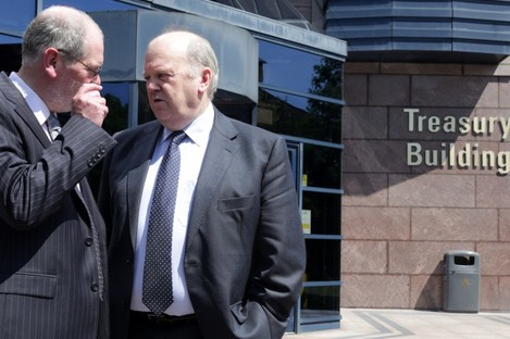 NTMA Chief Executive John Corrigan (left) and Minister for Finance Michael Noonan TD speak outside Treasury Building.