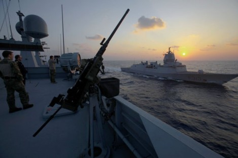 Danish warship Esbern Snare and Norwegian warship Helge Ingstad pass each other during a sunset at sea between Cyprus and Syria.
