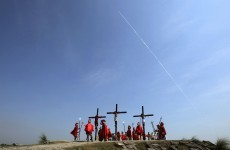 24 Filipinos crucified on wooden crosses
