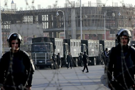 Egyptian security forces stand guard outside a court ahead of the trial of ousted President Mohammed Morsi.