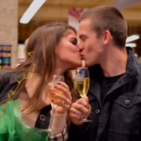Guy proposes to his girlfriend in the supermarket where they first met