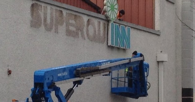 Pic: Superquinn sign is taken down to be replaced by SuperValu