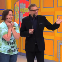 Game show contestant trips over, head-butts announcer in the crotch