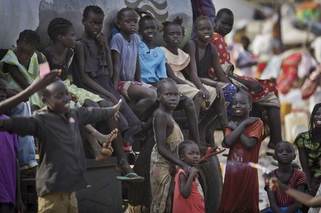 Displaced children gather on top of a truck at a United Nations compound in South Sudan.
