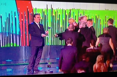 Chris Noth, aka Mr Big, waits to present the award to Brendan O'Carroll.