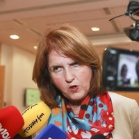 Burton defends welfare checks on widows and widowers