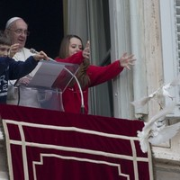 Peace doves released by the Pope are immediately attacked by a seagull and crow