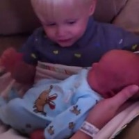 Two-year-old meets his baby brother for the first time
