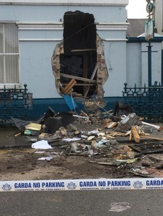ATM ripped from bank wall using digger in early morning raid