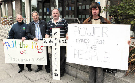 Seamus Sherlock from Limerick (with cross) and fellow proestors outside ESB HQ