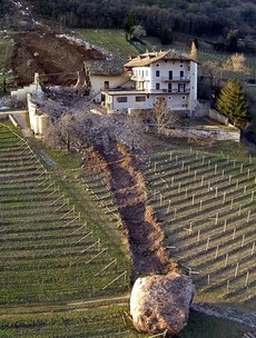 Yikes! Thankfully, no-one was hurt when this massive boulder smashed through an Italian farmyard
