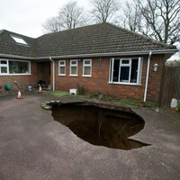 Well hole-y god: Giant sinkhole swallows family car