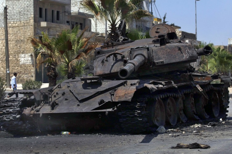 The remains of a destroyed military tank is seen on a street in the town of Hanano in Aleppo, Syria.