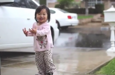 Little girl experiences rain for the first time, reacts adorably