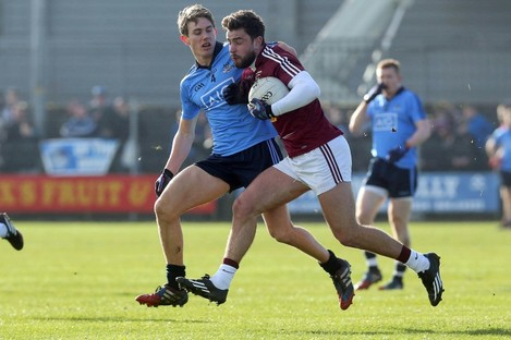 Michael Fitzsimmons of Dublin with Paul Sharry of Westmeath.