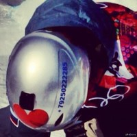 Russian snowboarder puts phone number on helmet, gets avalanche of nude photos
