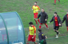 Player celebrates goal with running headbutt into dugout