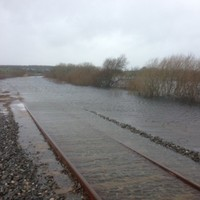 Rail track that was raised by 60 centimetres... is now 50 centimetres under water