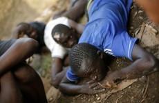 Girl (11) found alive amongst dead bodies after village massacre