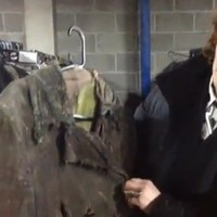 A cheese grater, paint and glue... how to 'break down' a coat for the stage