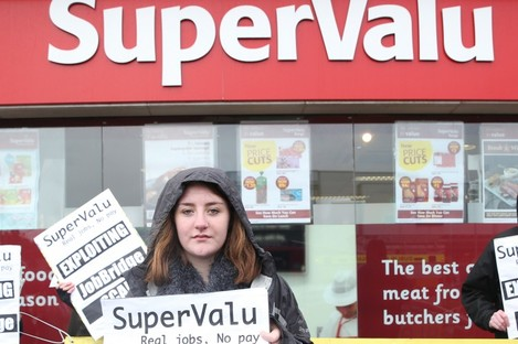 ScamBridge.ie protester Marie Hamrock outside the store.