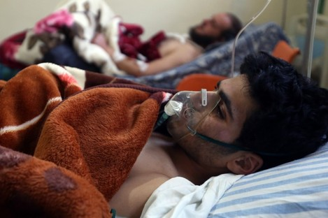Mohsin Awad (20) who was wounded in Yabroud as a result of Syrian government shelling, rest in a field hospital at the Lebanese-Syrian border town of Arsal, in eastern Lebanon