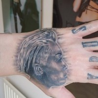 That lad with all the Miley Cyrus tattoos got another one