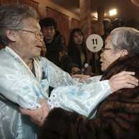 Sad scenes as families are reunited for first time since Korean War