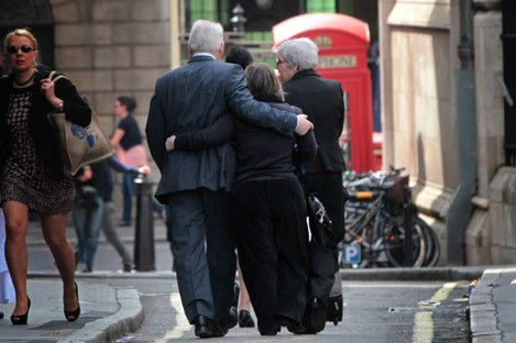Families of the victims of the 7/7 bombings leave the high court in London today following the inquest verdict.