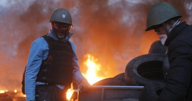 EU adopts sanctions against Ukraine; dozens killed during fighting