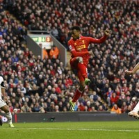 Liverpool still in the title hunt after seven-goal thriller