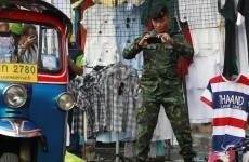 Fears of further political violence mount after two die in Bangkok grenade attack