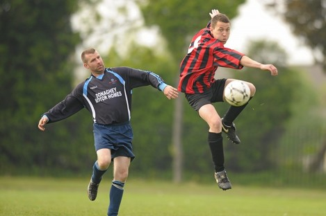 Jonathan O'Brien, Cheeverstown House, in action against Adrian Clarke, Donegal Special Olympics Club in the Cup Final of the Special Olympics Ireland National Cup Finals in St. Joseph's Boy's Football Club in Sallynoggin, Dublin.
